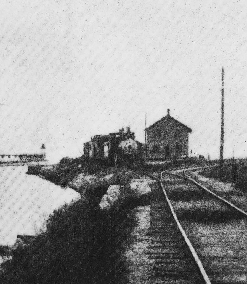 Locomotive with Algoma (then Ahnapee) Pier in the background.